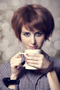 Style girl in shirt with cup at studio.