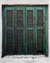 Fotomurales - Wooden turquoise window on a white house in Sarti, Greece