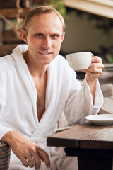 Attractive man with morning cup of coffee
