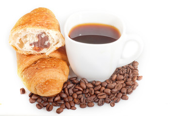 Croissant with coffee and beans on white background