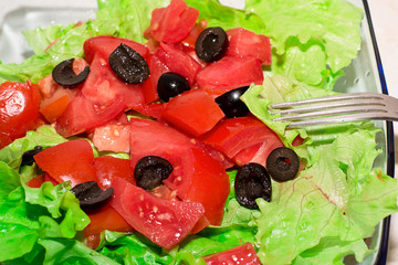 Delicious salad with tomatoes, olives and peppers.