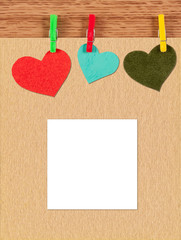 card with hearts on wooden background