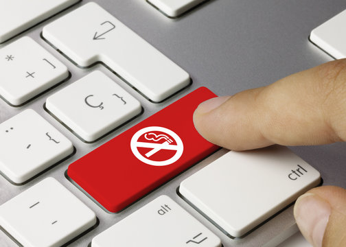 No smoking icon keyboard key. Finger