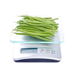 Bunch of Green Beans on an Electronic Kitchen Scale