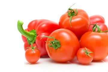 fresh vegetables - tomatoes and peppers on a white background