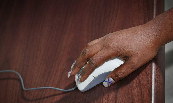 Hand of African-American woman with computer mouse