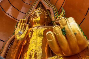 Big golden Buddha in temple, Kanchanaburi province Thailand
