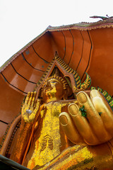 Big golden Buddha in temple, Kanchanaburi province Thailand