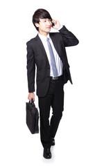 Business man Walking while talking phone