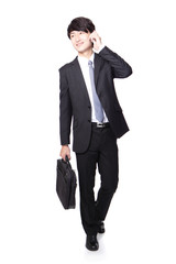 Business man Walking and speaking mobile phone