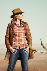 beautiful blond cowgirl in the desert