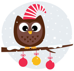 Cute christmas owl sitting on the branch