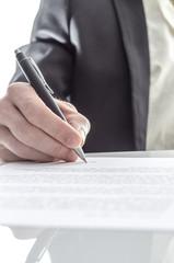 Businessman signing closeup