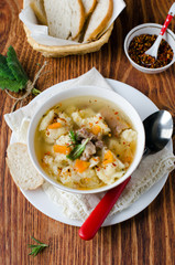 Meat soup with dumplings