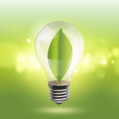 Bulb with a green sheet inside on a illumination background.