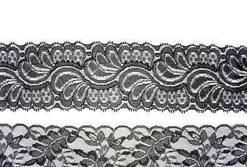 Black lace with pattern in the manner of flower on white backgro