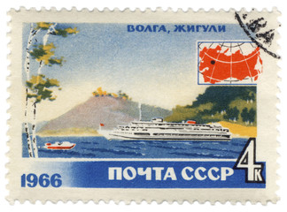 Volga river with passenger ship on post stamp