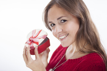 Happy young woman opening a valentine's day gift