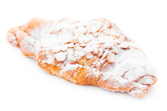 Croissant with almond on a white background