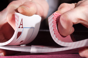 men's hands at the gaming table