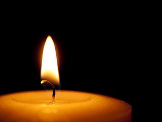 Single candle close - black background