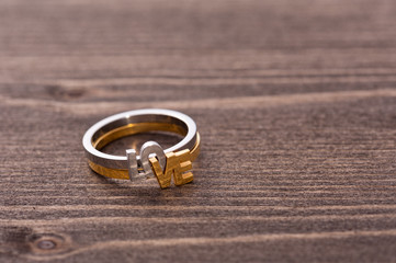 Engagement ring on wooden table