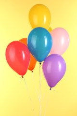 colorful balloons on yellow background