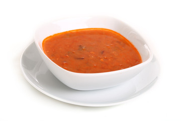 Image of bowl of hot red soup isolated