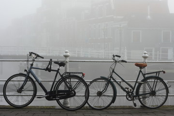 Leiden canal and bicycles in thick fog