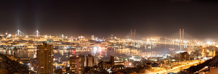 Vladivostok cityscape night view from east to west, panorama.