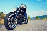 man posing on a custom made motorcycle stock photo and. Black Bedroom Furniture Sets. Home Design Ideas