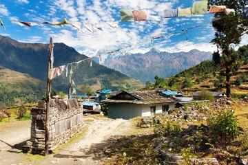 Wall Murals Nepal Prayer wall, prayer flags and village in Nepal