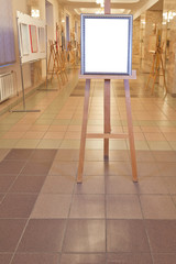 silver picture frame easel in art gallery hall