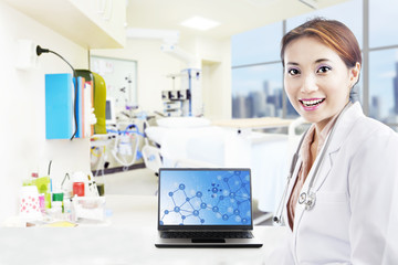 Beautiful scientist and laptop at hospital