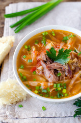 Tomato soup with meat and cabbage