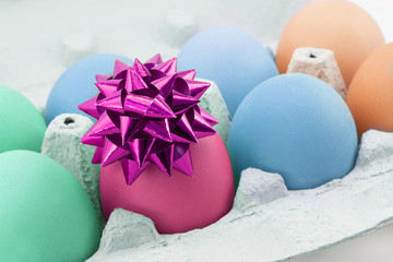 colored egg with bow