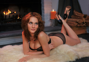 Beautiful tall redhead dressed in elegant lingerie