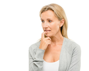Mature woman worried about the future isolated on white backgrou