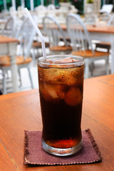 A glass of cola on a table