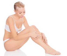 Woman in white underwear sitting on a floor