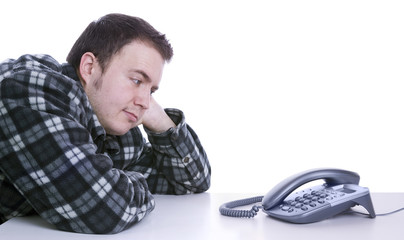 man waiting for phone to ring