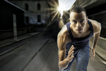 Young black male running in an urban setting
