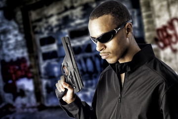 black male holding a handgun
