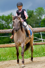 Horse riding - lovely girl is riding on a horse