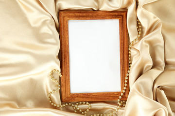 empty frame on beautiful silk