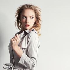 Elegant fashionable woman in a gray coat