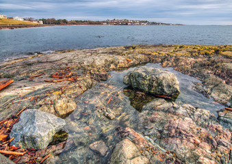 Fototapete - Rocks and view across water in Victoria British Columbia