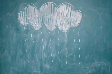 Drawing of rain falling from cloud on chalkboard