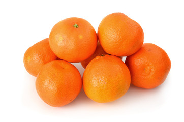 A couple of clementines on white background