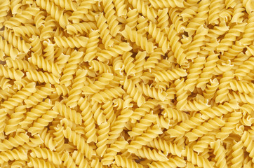 Some fusilli pasta as background pattern